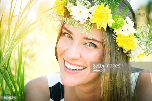 Cute girl with a flowers on her head