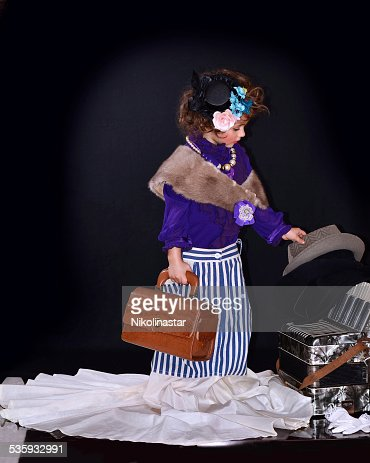 Cute girl with a little vintage suitcase : Stock Photo