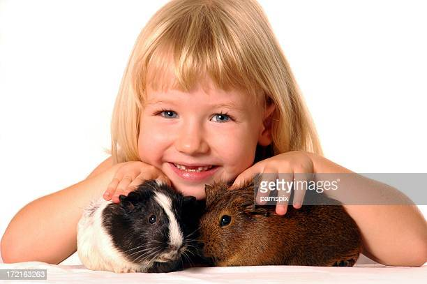 Cute Girl with Guinea Pigs