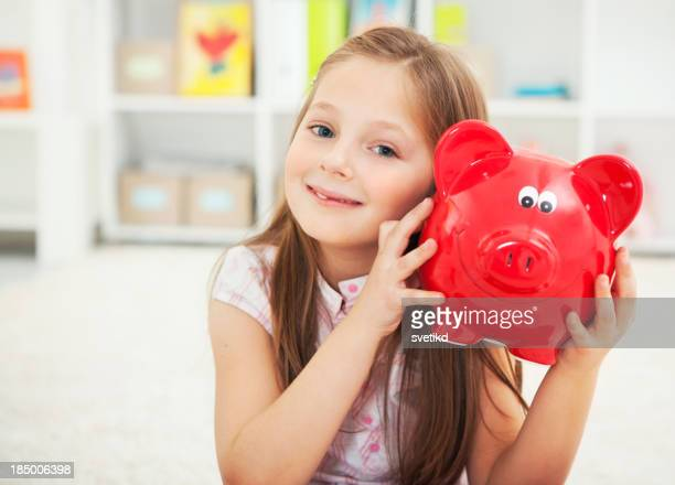 Cute girl with piggy bank.