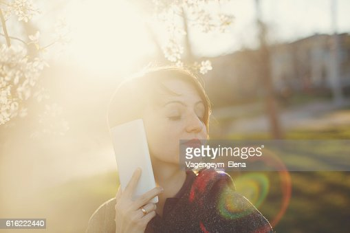 Cute girl with the phone. : Stock Photo