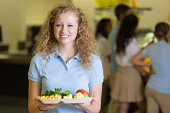 Cute high school student looking disgusted by cafeteria food