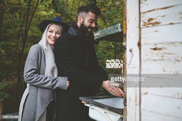Cute hipster couple in front of a vintage camper trailer