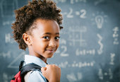Cute little African school girl in classroom