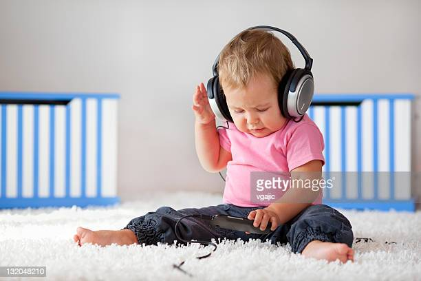 Cute Little Baby Listening Music with Headphones