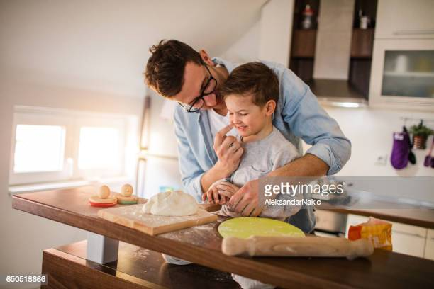 Cute little baker and his father