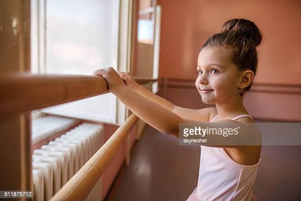 Cute little ballerina in dance studio.