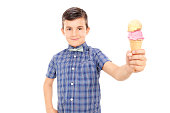 Cute little boy holding an ice cream isolated on white background