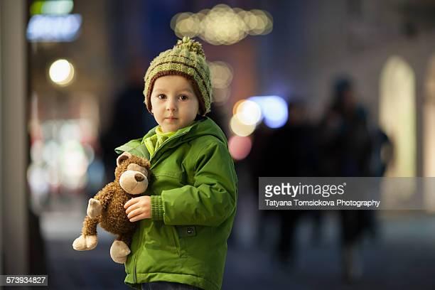 Cute little boy, holding little fluffy monkey