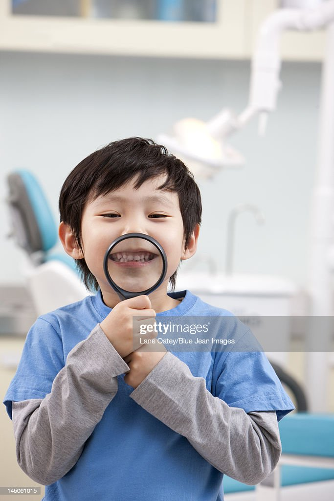 Cute little boy in dental clinic : Stock Photo