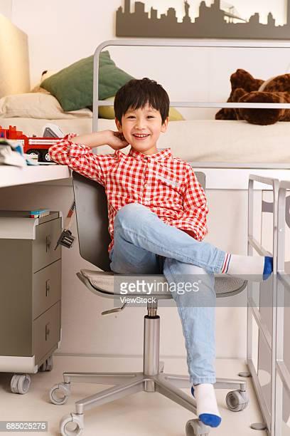 Cute little boy in the bedroom