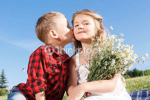 Cute little boy kissing girl stock photo thinkstock cute little boy kissing girl stock photo thecheapjerseys Gallery