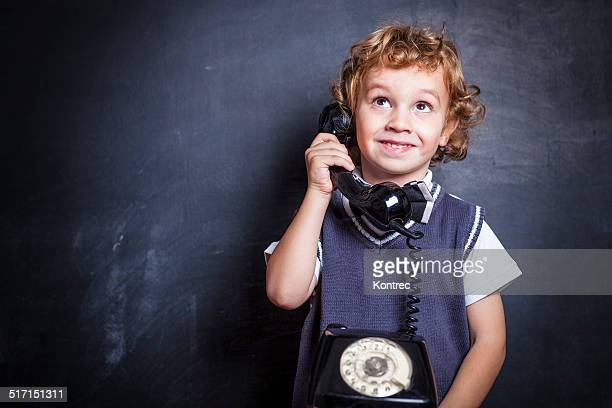 Cute little boy on the phone