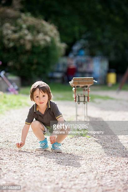 Cute little boy, playing on the playground