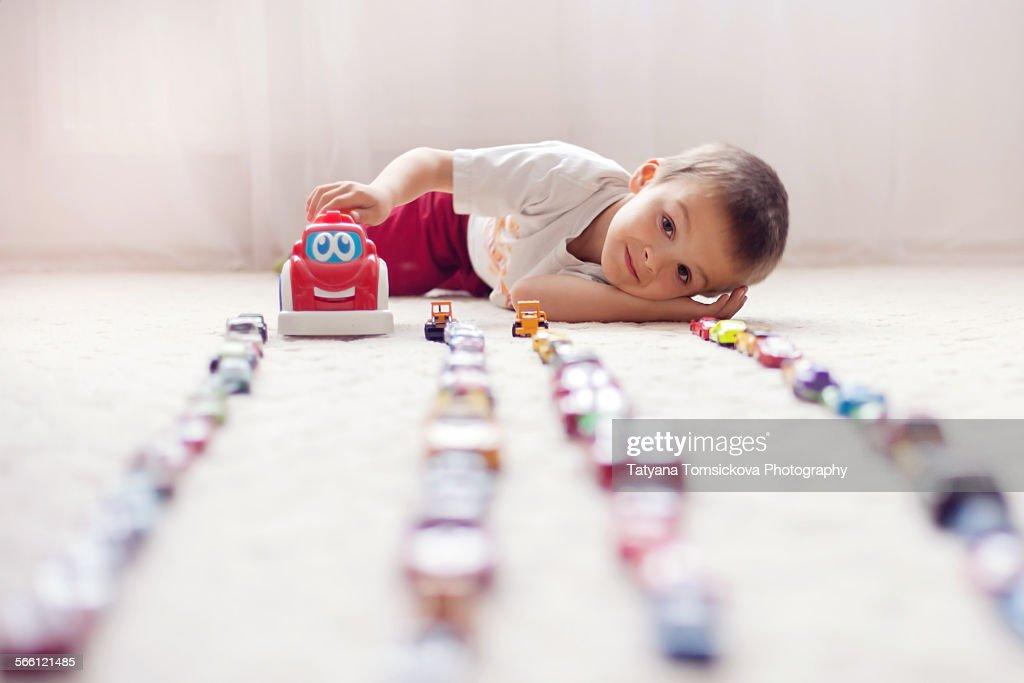 Cute Boy Using Toy