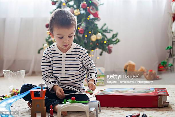 Cute little boy, playing with toys at Christmas