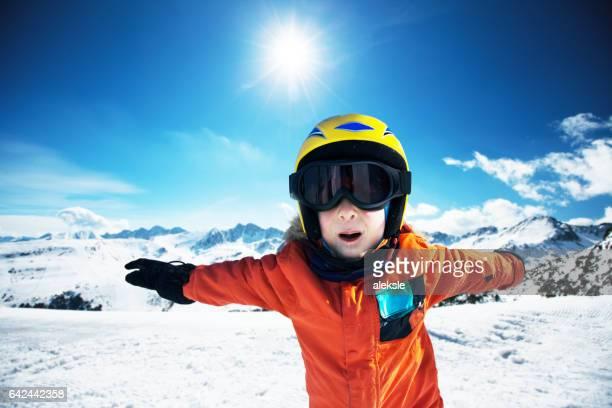 Cute little boy posing on camera in Andorra ski resort