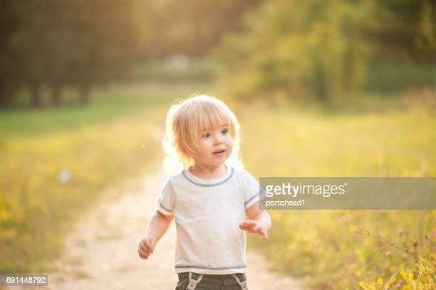 Cute little boy walking in a park