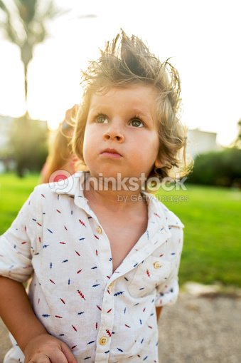 Cute Little Boy With Funky Hairstyle In Nature Stock Photo Thinkstock
