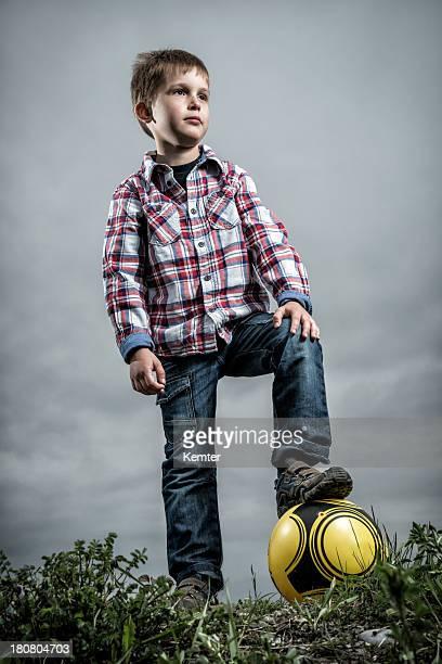 cute little boy with soccer ball