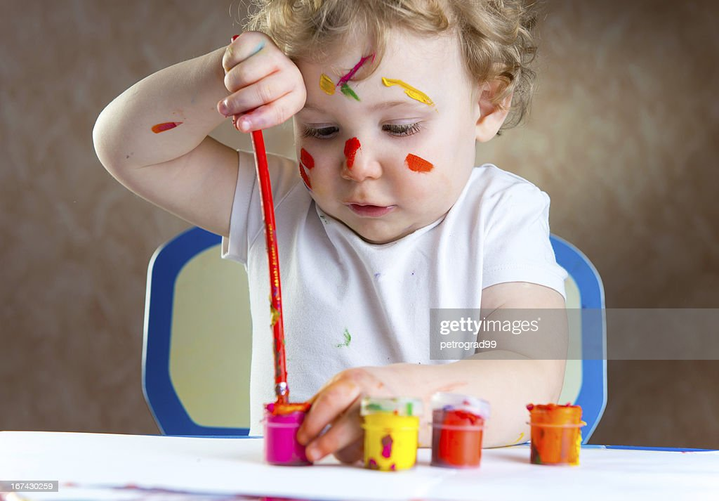 Cute little child painting : Stock Photo