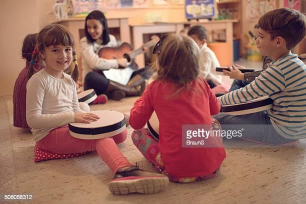 Cute little girl during a music class in a preschool.