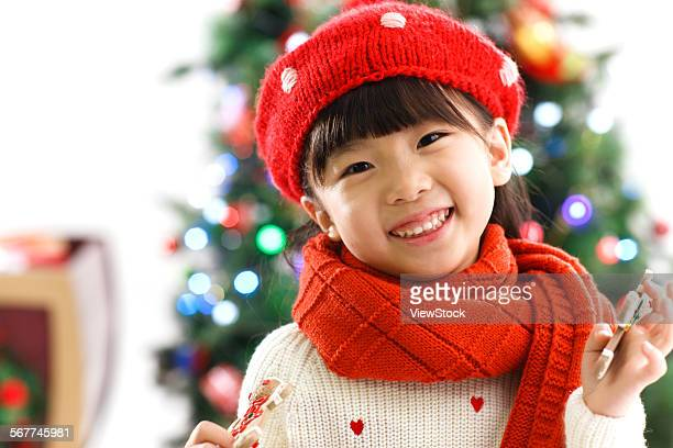 Cute little girl holding a toy for Christmas