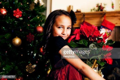 Cute Little Girl Holding Poinsettias