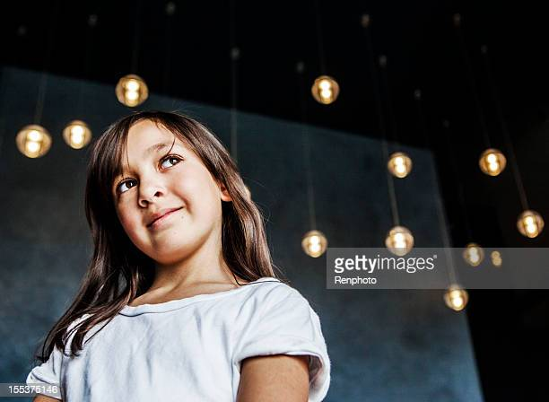 Cute Little Girl In Front of Hanging Lights