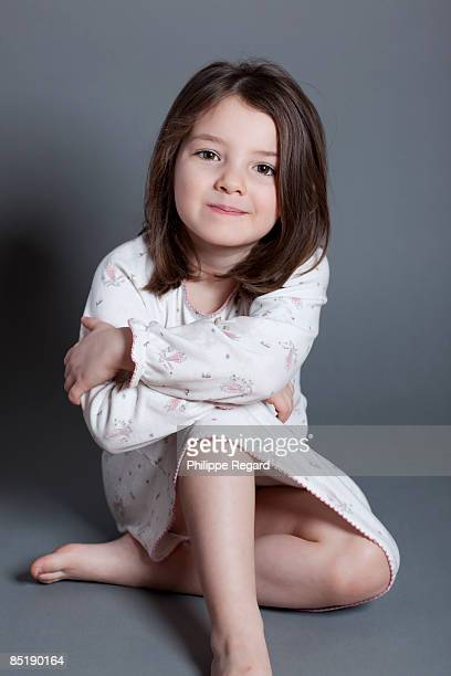 Cute little girl in nightdress, smiling at us