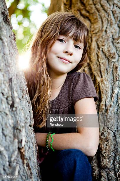 Cute Little Girl in Tree