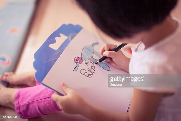 Cute little girl is drawing