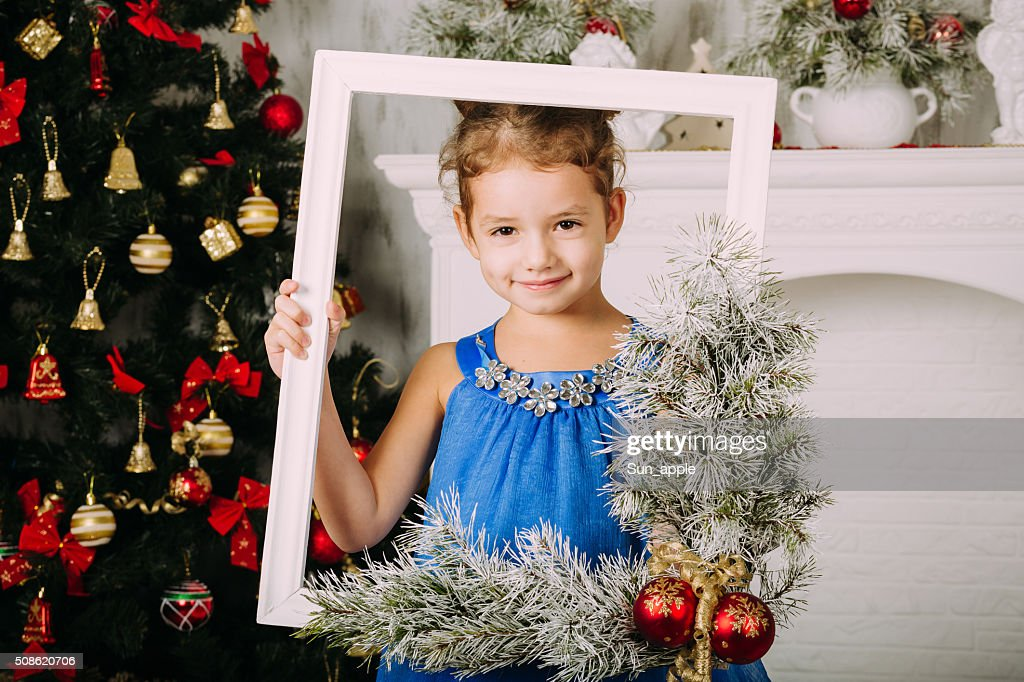 Cute little girl looking through the frame : Stock Photo