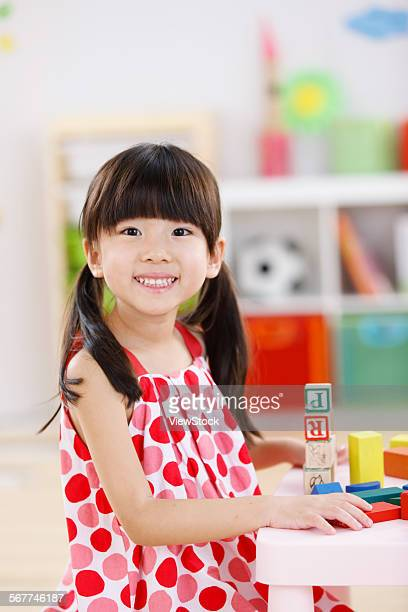 Cute little girl playing in the kindergarten