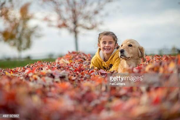 Cute Little Girl Playing with Her Dog