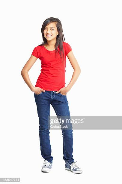Cute little girl posing with hands in pockets