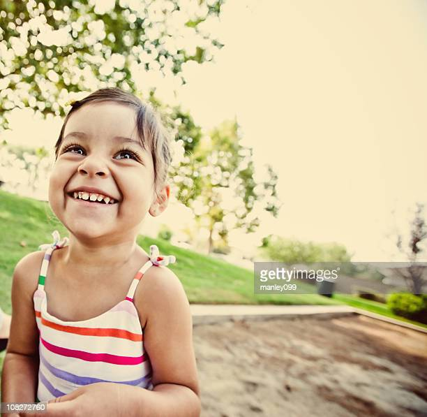 cute little girl smiling at the park
