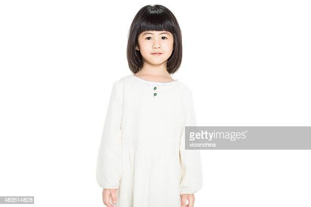 cute little girl standing in studio