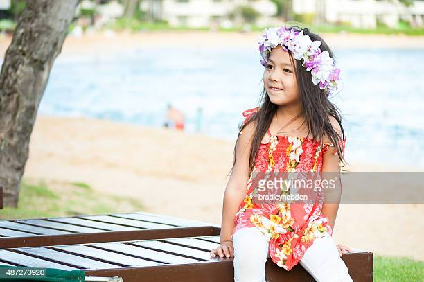 Cute little girl wearing a lei on a Hawaiian beach