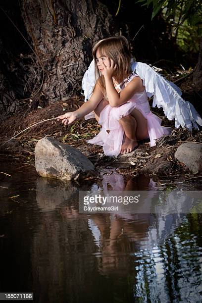 Cute Little Girl Wearing Fairy Costume Outdoors in Forest