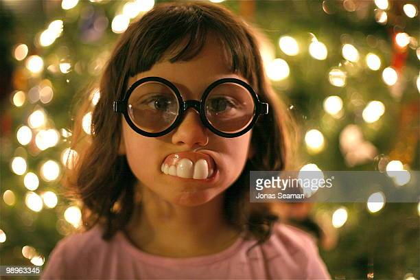 Cute Little Girl with funny glasses and fake teeth