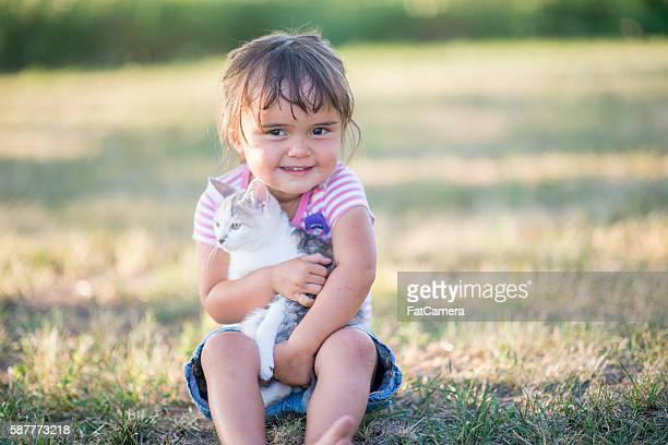 Cute Little Girl with Her Kitten