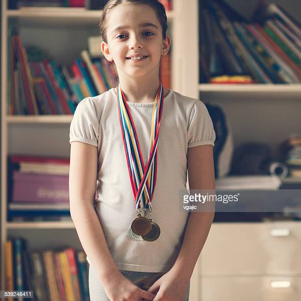 Cute Little Girl With Her Medals.