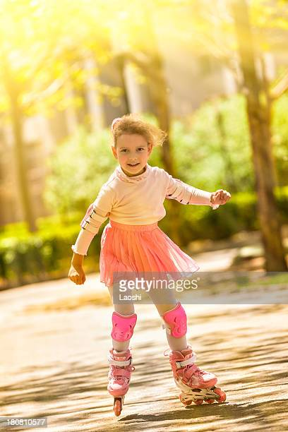 Cute little girl with roller blades