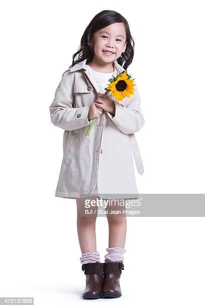 Cute little girl with sunflower