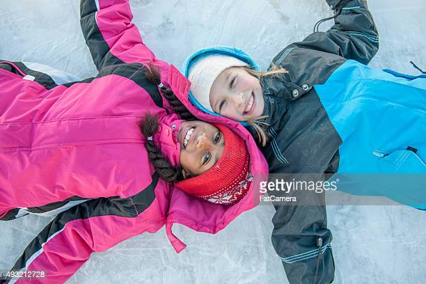 Cute Little Girls Lying on the Ice