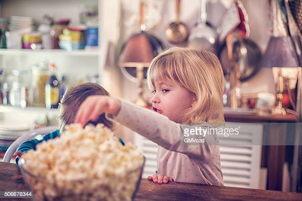 Cute Little Kids Eating Homemade Popcorn
