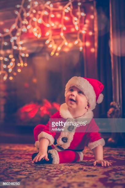Cute little Santa near fireplace