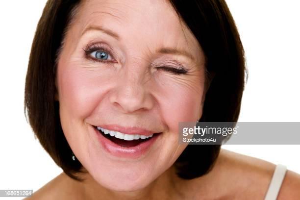 Cute mature woman winking
