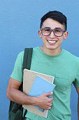 Cute middle school boy outside classroom.
